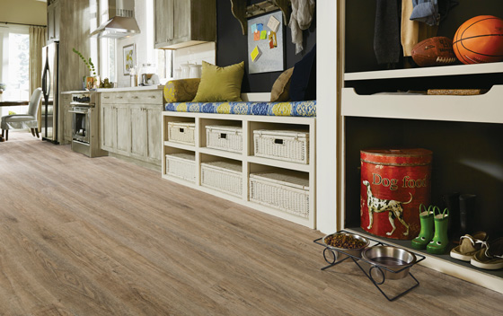 Vinyl plank is highly durable, looks and feels like real wood, and is friendlier to budgets than solid hardwood or tile