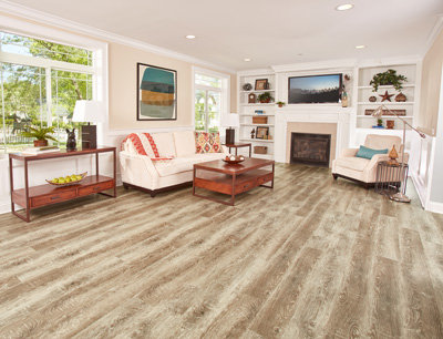 Vinyl combines the appealing look of wood, stone or tile in your living room or family room space with a more comfortable feel and an affordable price