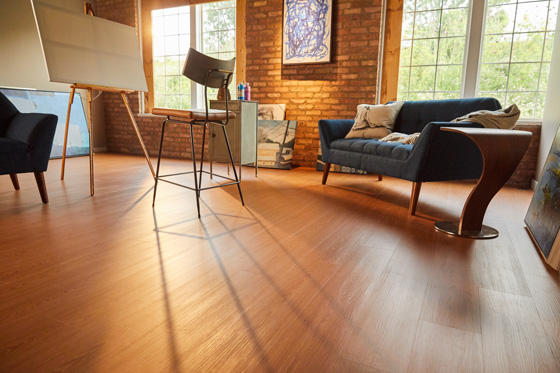 Vinyl plank is highly durable, looks and feels like real wood, and is friendlier to budgets than solid hardwood