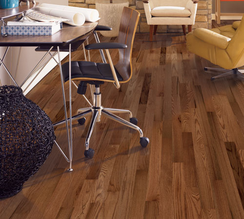 Solid hardwood and engineered hardwood can create a time-honored look for your office or study