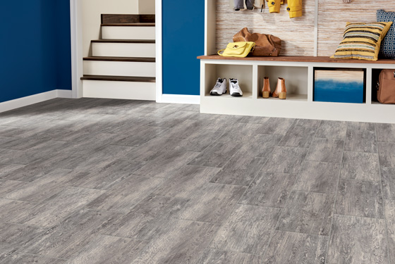 Vinyl tile provides the beautiful look of stone or porcelain tile, but has a softer surface