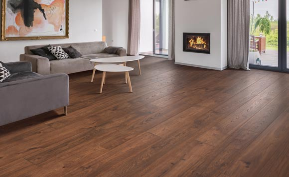 Beach House waterproof laminate floor from Empire Today in a home with a fire place and modern décor.