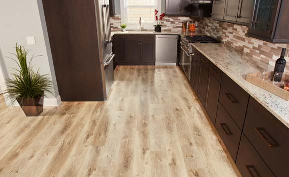 Grand Junction waterproof vinyl plank floors from Empire Today on display in a brand new kitchen.