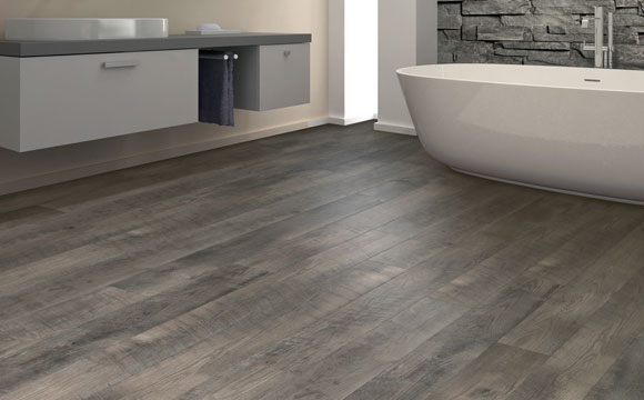 Sunset Drive waterproof laminate from Empire Today in a contemporary bathroom with a raised sink and modern bathtub.