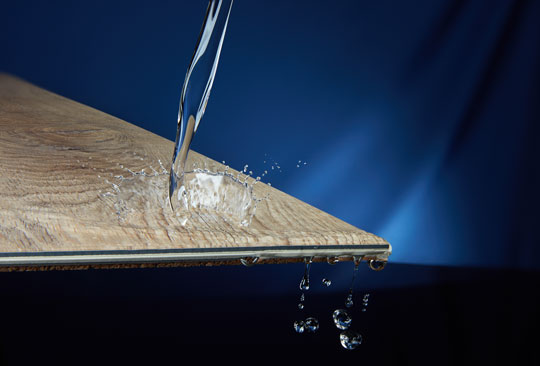 closeup of waterproof vinyl plank floor with water splashing on the surface Aqua Defense, available only at Empire Today, counteracts the accidents that happen in our busy lives. Aqua Defense is not just water resistant – it's 100% waterproof flooring. Furnish your home with extremely durable laminate or vinyl plank, even in rooms that are prone to moisture (such as bathrooms, laundry rooms, and basements). Waterproof wood look floors are no longer a pipe dream – they're the new standard for smarter, easier to clean flooring.