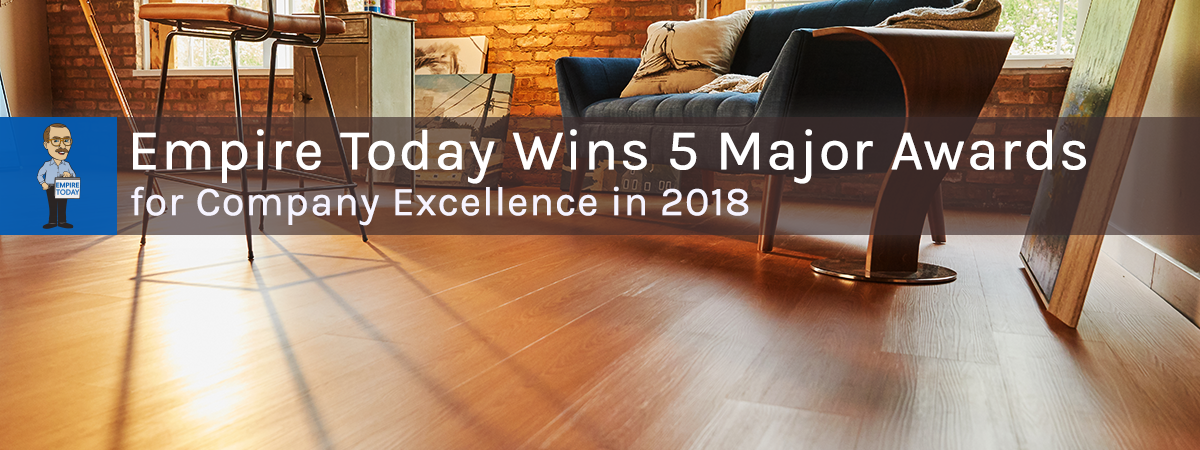 Empire Today Wins Five Major Awards for Company Excellence in 2018 Hero Image with Light Brown Luxury Vinyl Plank in a Contemporary Setting.