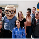 Empire Man poses with employees
