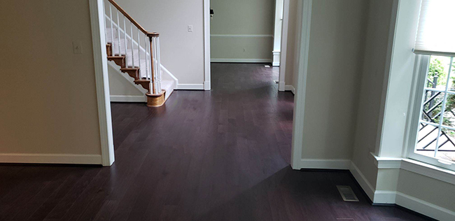 durable engineered hardwood flooring in the foyer and living room