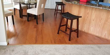 hardwood in the kitchen and carpet in the living toom