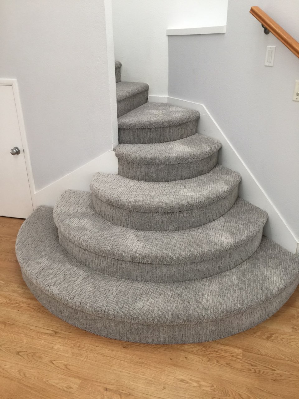 pattern carpet on rounded stairs
