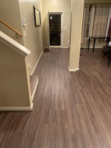 vinyl plank flooring in the hallway and dining room