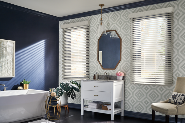 white faux-wood blinds in a bathroom with blue walls