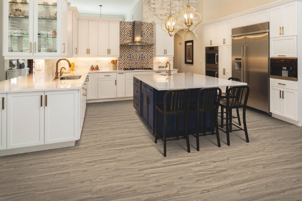 Light colored wood vinyl plank kitchen floor