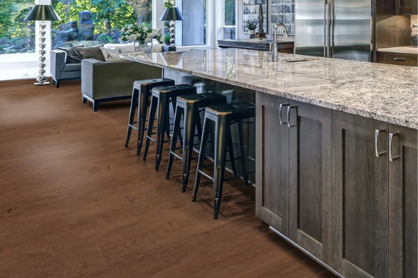 100% waterproof vinyl plank flooring in a kitchen with oversized island