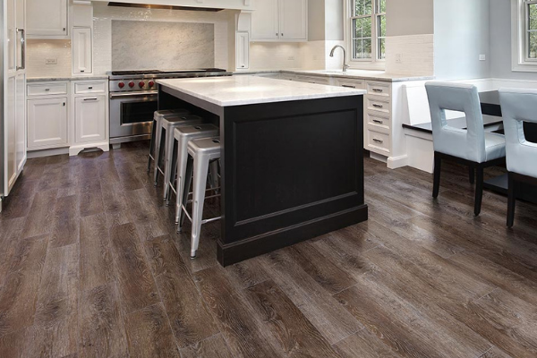 Luxury vinyl plank kitchen floor, warm stain color