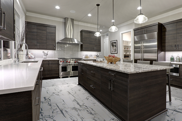 Carrara marble vinyl tile kitchen flooring with dark wood cabinets